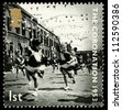UNITED KINGDOM - CIRCA 2003: British Postage Stamp celebrating the 50th Anniversary of the Coronation in 1953 of Queen Elizabeth 2nd, showing a street party, circa 2003 - stock photo