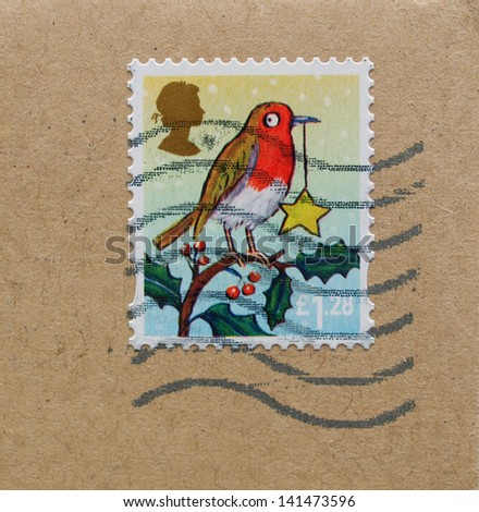UNITED KINGDOM, circa 2012 - mail stamp bearing the portrait of a robin, released in the United Kingdom, circa 2012 - stock photo