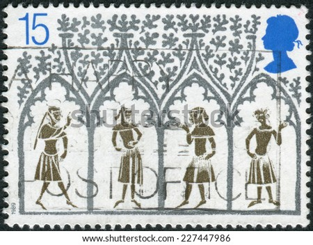 UNITED KINGDOM - CIRCA 1989: Postage stamp printed in England, is dedicated to 800th Anniversary of Ely Cathedral, shows a 14th Century Peasants from Stained-glass Window, circa 1989  - stock photo