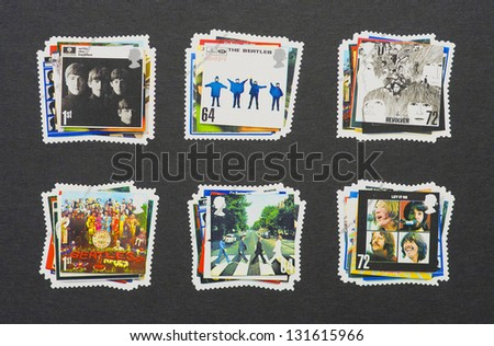 UNITED KINGDOM - CIRCA 2007: six postage stamps printed in United Kingdom showing images of The Beatles album covers, circa 2007. - stock photo