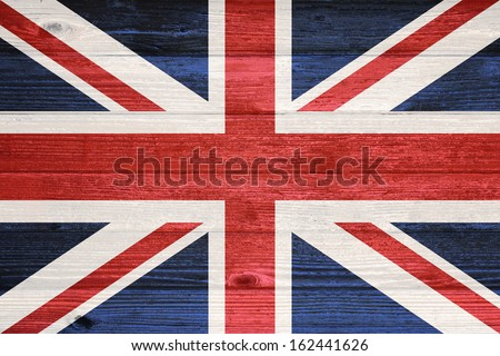 United Kingdom Flag painted on old wood plank background - stock photo