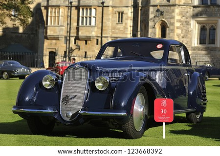 UNITED KINGDOM - SEPTEMBER 13: A classic Alfa Romeo on display at the United Kingdom Concours d'elegance Classic Car Expo at Windsor Castle on September 13, 2012 in Windsor, United Kingdom. - stock photo