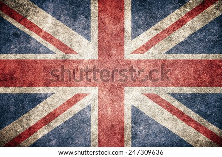 United Kingdom UK flag on the grunge concrete wall - stock photo
