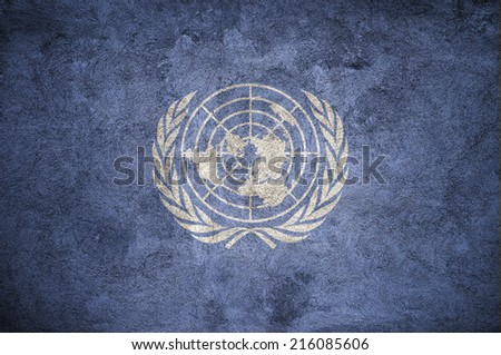 United Nations UN flag on the grunge concrete wall - stock photo