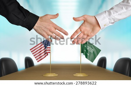 United States and Saudi Arabia diplomats agreeing on a deal - stock photo