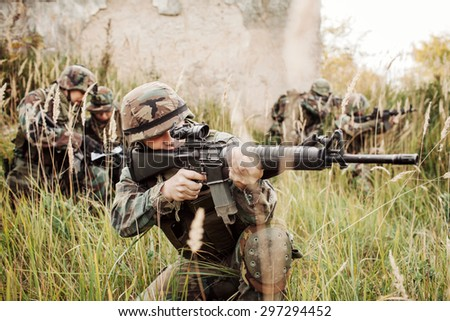 United States Army rangers during the military operation in city - stock photo