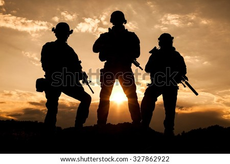 United States Army rangers on the sunset - stock photo