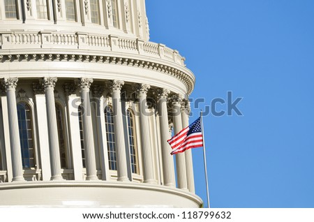 United States Capitol Building dome detail with waving US flag - Washington DC United States