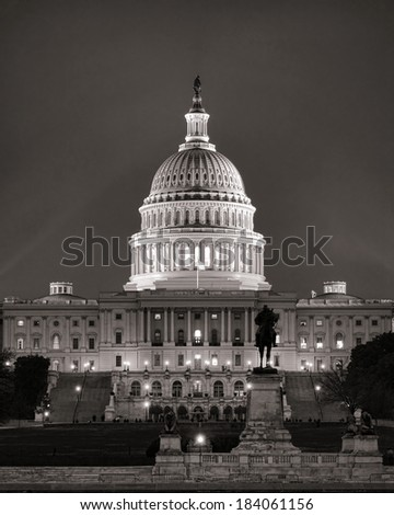 United States Capitol building dome over the West Central Front entrance and stairs behind Grant memorial statue in Union Square from the mall in US American nation capital of Washington DC at night - stock photo