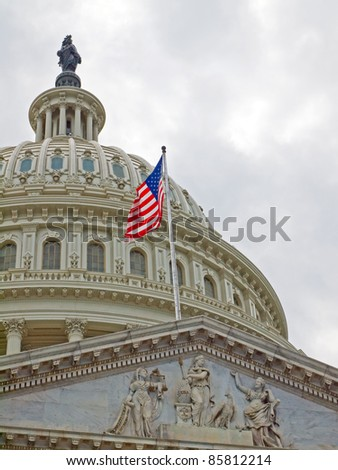 United States Capitol Building in Washington DC with American Flag - stock photo