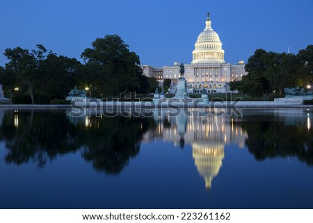United States Capitol, Government in Washington, D.C., United States of America. Illuminated at night with reflection showing in reflecting pool.  - stock photo