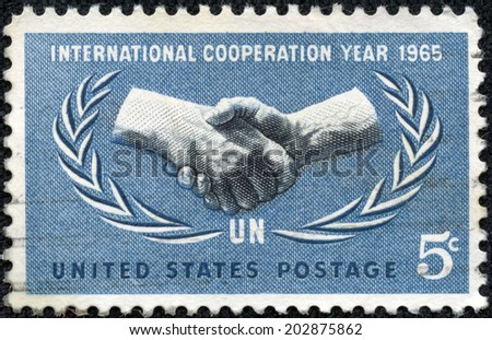 UNITED STATES - CIRCA 1965: A 5 cents stamp printed in the United States shows International Cooperation Year Emblem, circa 1965 - stock photo
