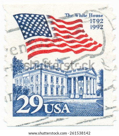 UNITED STATES - CIRCA 1992: A postage stamp printed in the United States, features waving US flag and White House, circa 1992 - stock photo