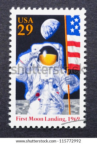 UNITED STATES -Â?Â? CIRCA 1994: A postage stamp printed in United States showing an image of the first moon landing, circa 1994. - stock photo