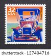 UNITED STATES - CIRCA 1998: a postage stamp printed in USA showing an image of a Ford model T car, circa 1998. - stock photo