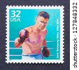 UNITED STATES - CIRCA 1998: a postage stamp printed in USA showing an image of boxer Jack Dempsey, circa 1998. - stock photo