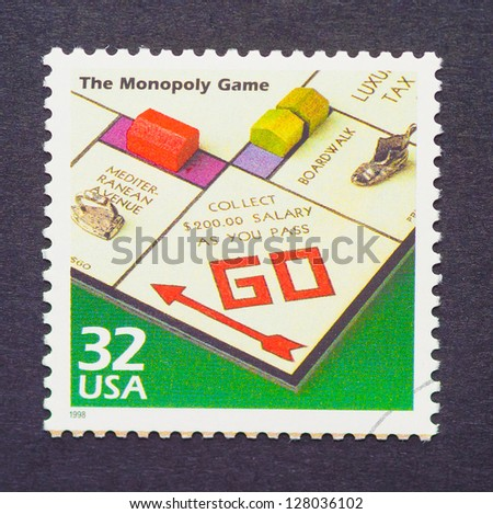 UNITED STATES  CIRCA 1998: a postage stamp printed in USA showing an image of monopoly game, circa 1998. - stock photo