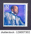 UNITED STATES � CIRCA 1998: a postage stamp printed in USA showing an image of social activist W.E.B. Du Bois, circa 1998. - stock photo