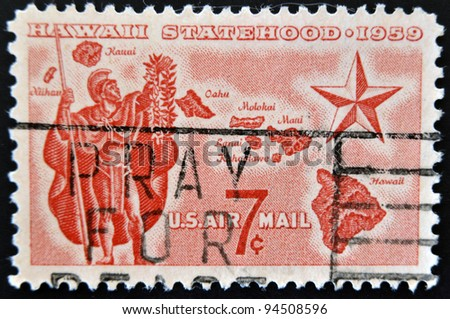 UNITED STATES - CIRCA 1959: A stamp printed in USA shows Alii Warrior, Map of Hawaii and Star of Statehood, circa 1959 - stock photo