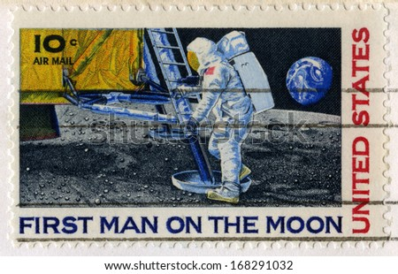 UNITED STATES, CIRCA 1969: A vintage 10 cent US Postal Stamp celebrating the First Moon Landing, circa 1969. - stock photo