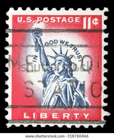 UNITED STATES - CIRCA 1970: An 11 cents stamp printed in the United States features statue of liberty and inscription In god we trust, circa 1970 - stock photo
