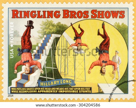 UNITED STATES - CIRCA 2014: forever stamp printed in USA shows Hillary Long; acrobat standing on head; riding on skates and wearing hat on feet; circus vintage posters; Ringling Bros shows; circa 2014 - stock photo