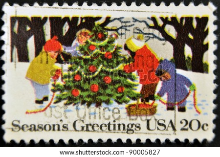 UNITED STATES - CIRCA 1982: stamp printed in USA, shows Children Decorating Christmas Tree, circa 1982