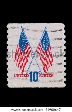 UNITED STATES: crossed flags postage stamp with perforations missing from top and bottom edges, circa 1973