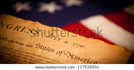 United States Declaration of Independence on a Betsy Ross flag background - stock photo
