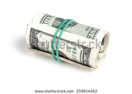 United States dollars, roll of hundred USD banknotes with green rubber isolated on white background with shadow. Selective focus - stock photo