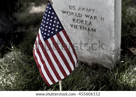United States Flag on grave sites at Arlington National Cemetery on Memorial Day - stock photo
