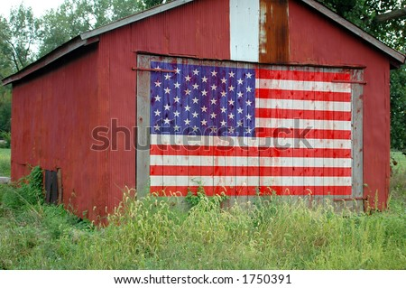 United States flag painted on barn door - stock photo