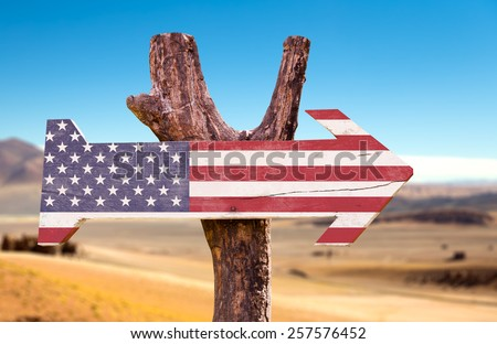 United States Flag wooden sign with a desert background - stock photo