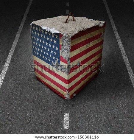 United States government shutdown roadblock obstacle business concept with a cement or concrete cube with an old American flag blocking a road or highway as an icon of political gridlock and embargo. - stock photo
