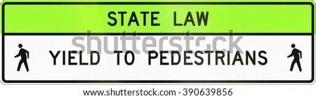 United States MUTCD crosswalk road sign - Yield to pedestrians. - stock photo