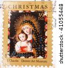 UNITED STATES OF AMERICA - 2006: A stamp printed in the United States of America shows image of a painting of Mary and baby Jesus, series, 2006 - stock photo