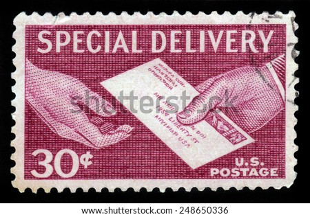 UNITED STATES OF AMERICA - 1957: A stamp printed in the USA shows hands and letter, postal service for special delivery of letters, 1957 - stock photo
