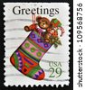 UNITED STATES OF AMERICA - CIRCA 1994: A greeting Christmas stamp printed in the USA shows a stocking with gifts, circa 1994. - stock photo
