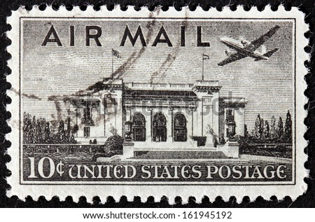 UNITED STATES OF AMERICA - CIRCA 1947: A stamp printed by USA shows airplane over Pan American Union Building, Washington, circa 1947