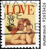 UNITED STATES OF AMERICA - CIRCA 1995: A stamp printed in the United States of America shows image of cupid, circa 1995 - stock photo