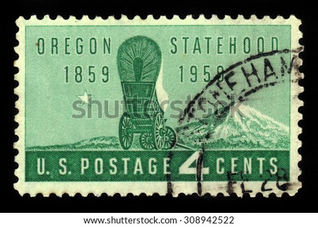 UNITED STATES OF AMERICA - CIRCA 1959: a stamp printed in the USA shows covered wagon and Mount Hood, Oregon statehood , centenary, circa 1959 - stock photo