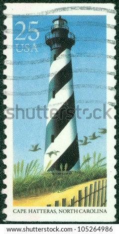 UNITED STATES OF AMERICA - CIRCA 1990: A stamp printed in the USA shows image of Cape Hatteras in North Carolina, circa 1990 - stock photo