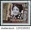 UNITED STATES OF AMERICA - CIRCA 2002: A stamp printed in USA dedicated to Women in Journalism, shows Ethel L. Payne, circa 2002 - stock photo
