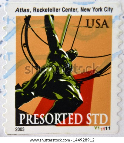 UNITED STATES OF AMERICA - CIRCA 2003: A stamp printed in USA shows Atlas in Rockefeller Center, New York City, circa 2003 - stock photo