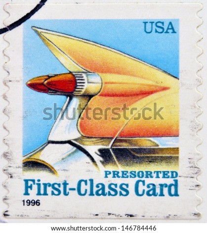 UNITED STATES OF AMERICA - CIRCA 1996: A stamp printed in USA shows auto tail fin, presorted first class card, circa 1996 - stock photo