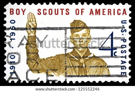 "UNITED STATES OF AMERICA - CIRCA 1960: A stamp printed in USA shows Boy Scout Giving scout sign, with inscription ""Boy Scouts of America"", series ""Boy Scouts of America, 50th anniversary"", circa 1960 - stock photo"