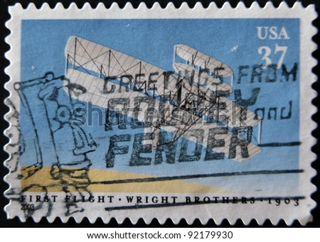 UNITED STATES OF AMERICA - CIRCA 2003: A stamp printed in USA shows image celebrating the 100th anniversary of the first flight by the Wright Brothers, circa 2003 - stock photo