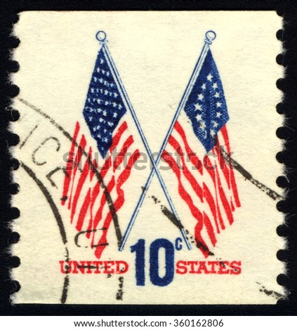 UNITED STATES OF AMERICA - CIRCA 1973: A stamp printed in USA shows Two US flag, circa 1973 - stock photo