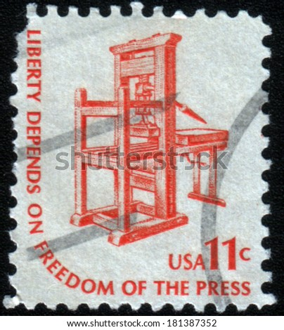 UNITED STATES OF AMERICA - CIRCA 1975: A stamp shows image of an early printing press, circa 1975 - stock photo