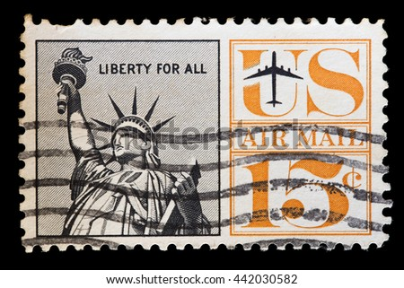 UNITED STATES OF AMERICA - CIRCA 1961: A used airmail postage stamp printed in United States shows an airplane flying near the Statue of Liberty, circa 1961 - stock photo